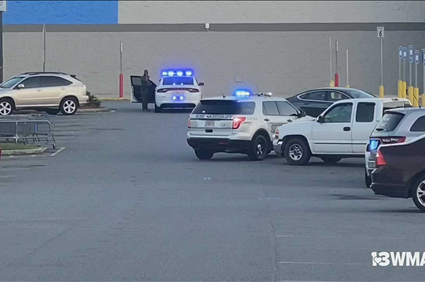 Woman arrested after shooting in Macon Walmart parking lot